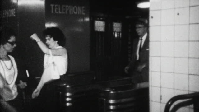 Passengers board New York City subways in the  1960s.
