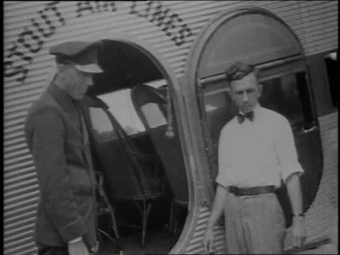 1929 montage passengers boarding an airplane / united states - flugpassagier stock-videos und b-roll-filmmaterial