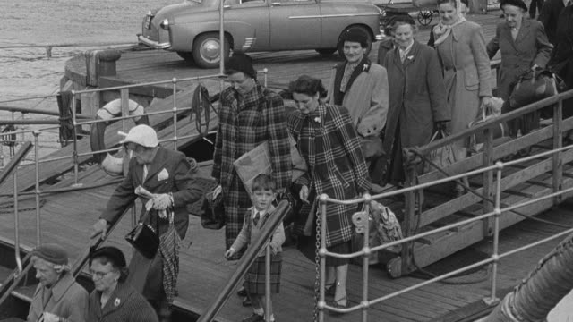 1956 MONTAGE Passengers boarding ferry / Scotland, United Kingdom