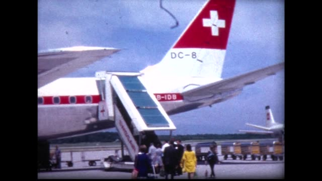 1968 passengers boarding swiss air flight and take off - anno 1968 video stock e b–roll