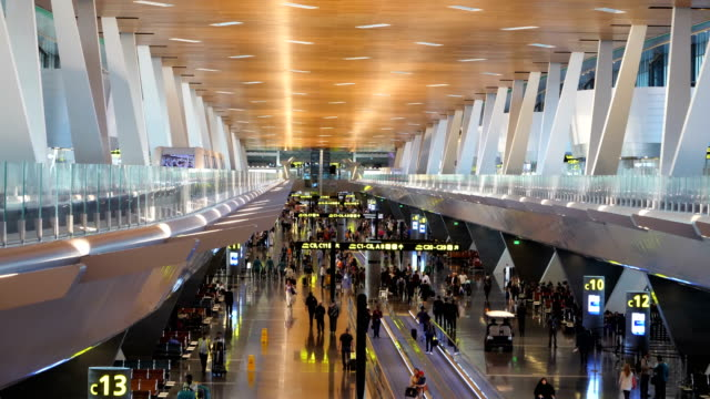 Passengers business travelers and tourists in the departure hall of the airport of Doha Qatar 4K resolution