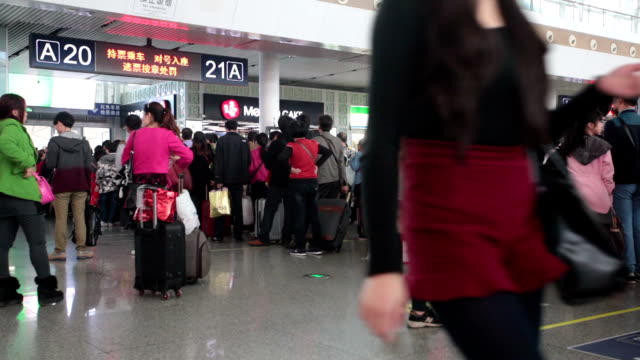 ms passengers check-in at highspeed railway station / guangzhou, china - transportation event stock videos and b-roll footage