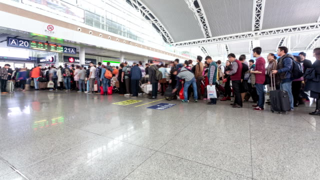 t/l ws passengers check-in at highspeed railway station / guangzhou, china - people in a line stock videos & royalty-free footage