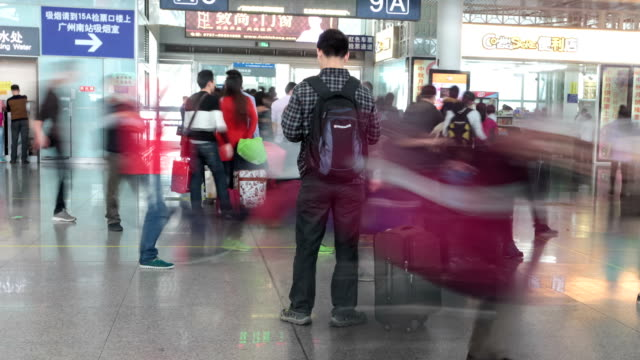 t/l ms zi passengers check-in at highspeed railway station / guangzhou, china - transportation event stock videos and b-roll footage