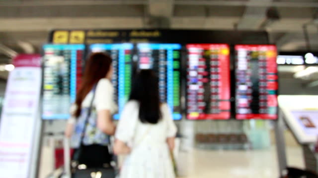 Passengers checking the flight schedule