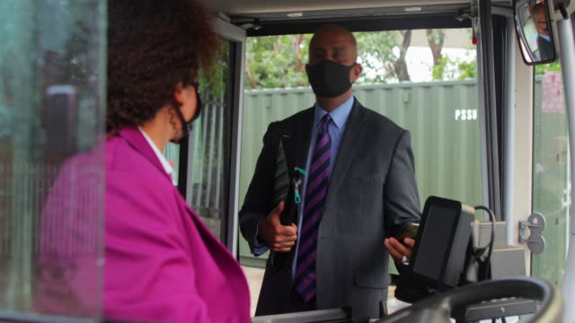 passengers commuting during a pandemic - bus driver stock videos & royalty-free footage
