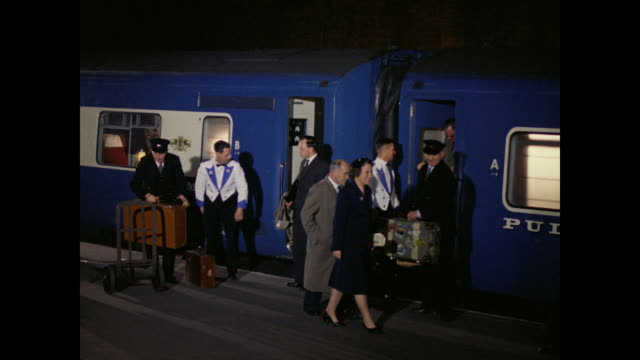 1960 - passengers, crew disembark blue pullman at st. pancras, london - passenger train stock videos & royalty-free footage