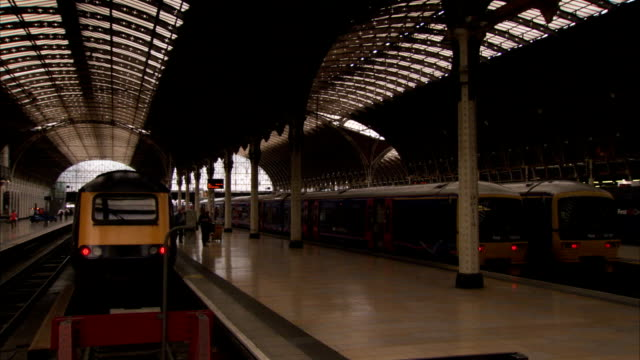 passengers depart a train at london paddington railway station. available in hd. - paddington railway station stock videos & royalty-free footage