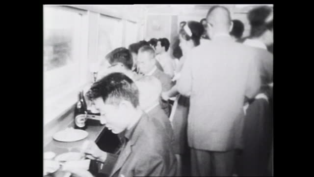 Passengers eat in the dining car of the first Hikari train
