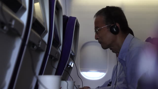 passengers enjoying movies and games on an airbus plane during flight - vehicle seat stock videos & royalty-free footage