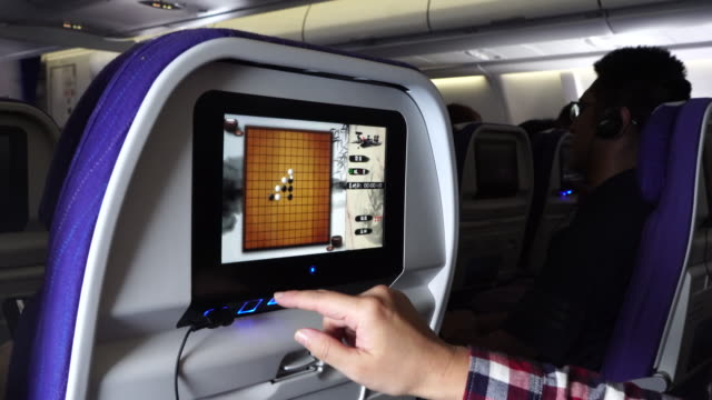passengers enjoying movies and games on an airbus plane during flight - airbus stock-videos und b-roll-filmmaterial