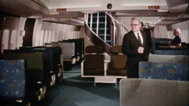 Passengers enter a spacious Boeing 747 aircraft.