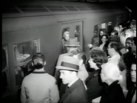 passengers enter and exit a subway train. - new york city 1950s stock videos & royalty-free footage