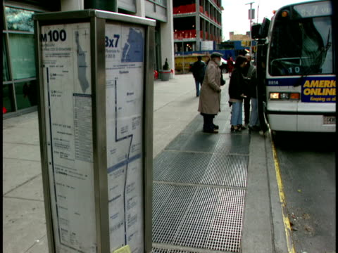 ms, passengers entering bus at bus stop, new york city, new york, usa - pavement stock videos & royalty-free footage
