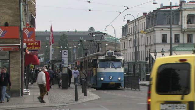 Passengers exit a streetcar in Gothenburg, Sweden.