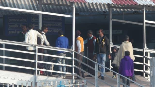 Passengers exiting a railway station platform