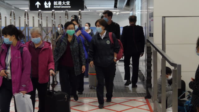 passengers from china arrive at west kolwoon railway station mostly hong kong residents arriving from fujian province china under heavy security and... - coronavirus stock videos & royalty-free footage