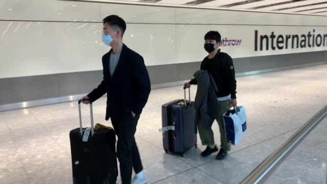 passengers from shanghai, on the last flight to leave mainland china for uk due to coronavirus, coming through arrivals at heathrow airport - flying stock videos & royalty-free footage