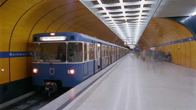 Passengers get on and off of subway trains at a subway station in Munich, Germany.
