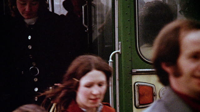 vídeos de stock e filmes b-roll de 1973 montage passengers getting off city bus, vehicle driving past factory buildings, shipping terminal loading area with forklift rolling through, vehicle driving over a river on a bridge / liverpool, england, united kingdom - liverpool inglaterra