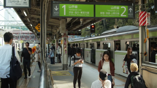passengers getting on and off tokyo yamanote line train - underground station stock videos & royalty-free footage