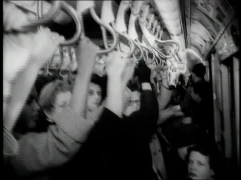 passengers hang on to the straphangers as they ride the subway. - new york city 1950s stock videos & royalty-free footage