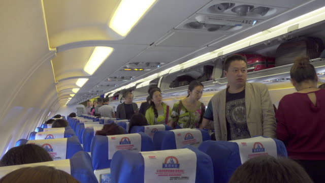 passengers in a commercial airplane/xi'an, shaanxi, china - passagierflugzeug stock-videos und b-roll-filmmaterial