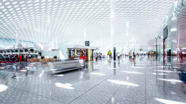 vídeos y material grabado en eventos de stock de t/l ws passengers in airport / shenzhen, china - aeropuerto