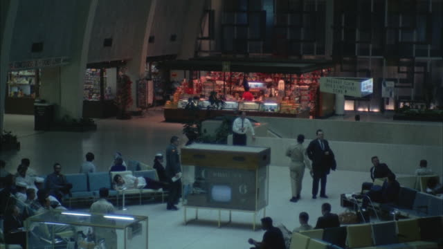 1967 WS Passengers in airport terminal