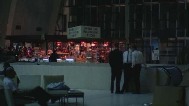stockvideo's en b-roll-footage met 1967 ws passengers in airport terminal - overhemd en stropdas