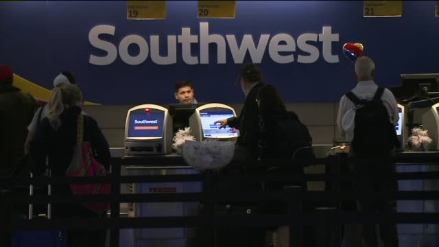passengers in line at southwest airlines' ticket counter in denver, colorado while the airline was having technical issues and flight delays on... - ticket counter stock videos & royalty-free footage