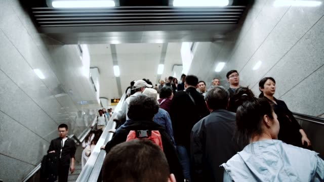 passengers in shanghai subway station, slow motion - commuter stock videos & royalty-free footage