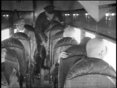 B/W 1927 passengers in Stout Air LInes airliner looking out of windows / newsreel