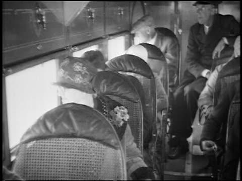 stockvideo's en b-roll-footage met b/w 1927 passengers in stout air lines airliner looking out of windows / newsreel - 1927