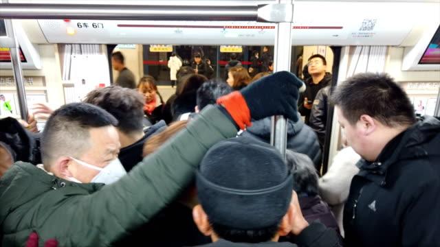 passengers in subway train, xi'an, china - bahnreisender stock-videos und b-roll-filmmaterial