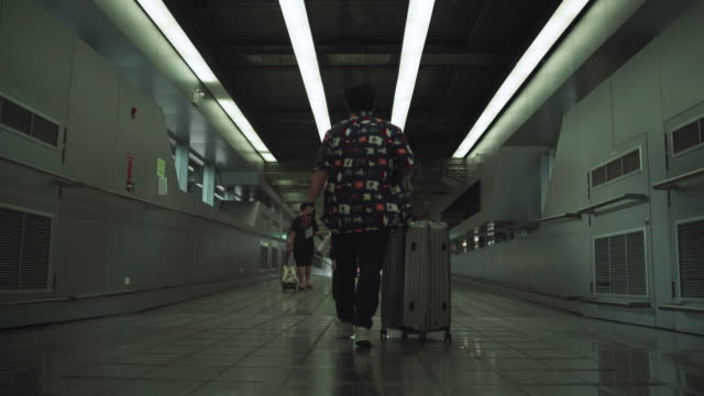 passengers in the airline walked to drag the luggage to the airport - transportation building type of building stock videos & royalty-free footage
