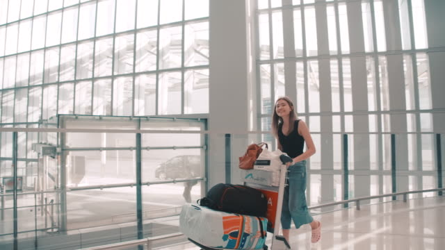 passengers in the airline walked to drag the luggage to the gate. in the passenger hall - airline check in attendant stock videos and b-roll footage