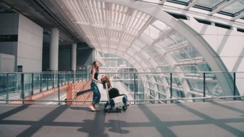 passengers in the airline walked to drag the luggage to the gate. in the passenger hall - gate stock videos & royalty-free footage