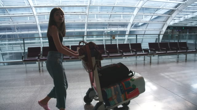 passengers in the airline walked to drag the luggage to the gate. in the passenger hall - cart stock videos & royalty-free footage
