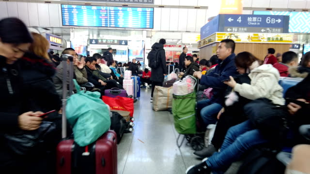 passengers in train station / tianjin, china - railway station stock videos & royalty-free footage