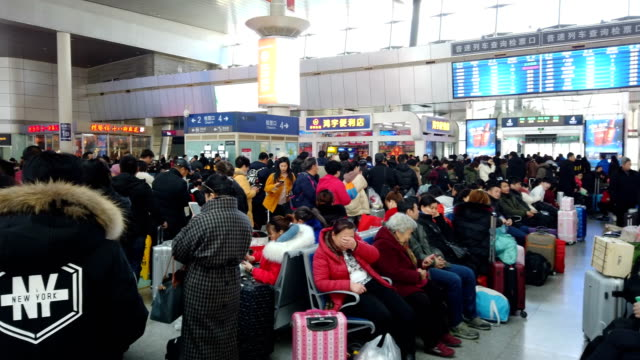 passengers in train station / tianjin, china - aspettare video stock e b–roll