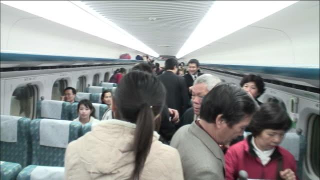 vídeos de stock, filmes e b-roll de passengers move inside the cabin of a car on the taiwanese 700t model highspeed train - model t