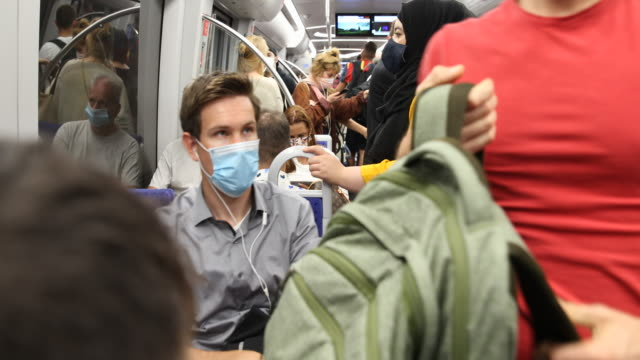 passengers of a subway wear prescribed protective face masks in a subway during the novel coronavirus pandemic on july 07 2020 in munich germany - rules stock videos & royalty-free footage