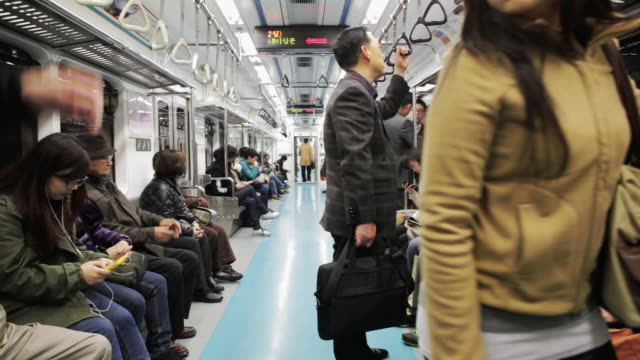 WS Passengers on a Seoul metro subway train / Seoul, South Korea