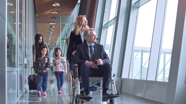 passengers on corridor at airport terminal - accessibility stock videos & royalty-free footage