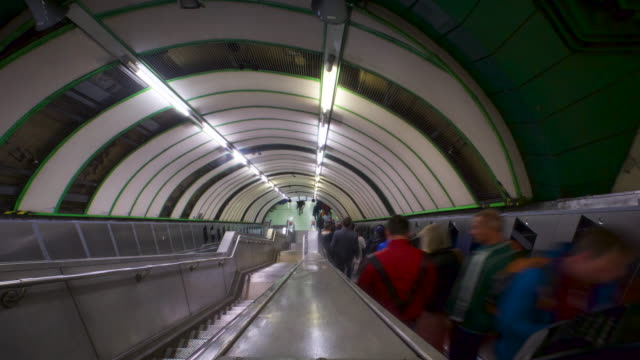 passengers on escalator - staircase stock videos & royalty-free footage