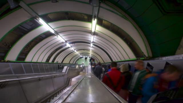 passengers on escalator - london underground stock videos & royalty-free footage