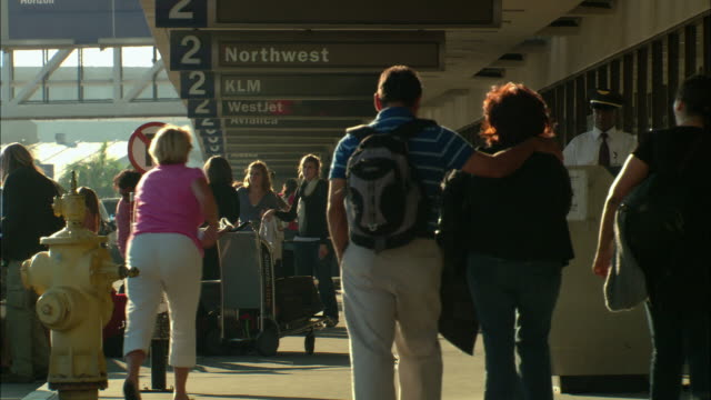 stockvideo's en b-roll-footage met ms, passengers on lax airport, los angeles, california, usa - lax airport