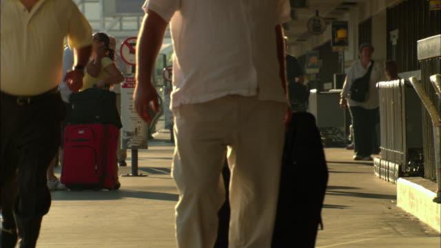 ms, passengers on lax airport, los angeles, california, usa - flugpassagier stock-videos und b-roll-filmmaterial