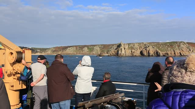 passengers on the scillonian, the ferry that runs from penzance to the scilly isles, passing sea cliffs near porthcurno. - mineral stock videos & royalty-free footage